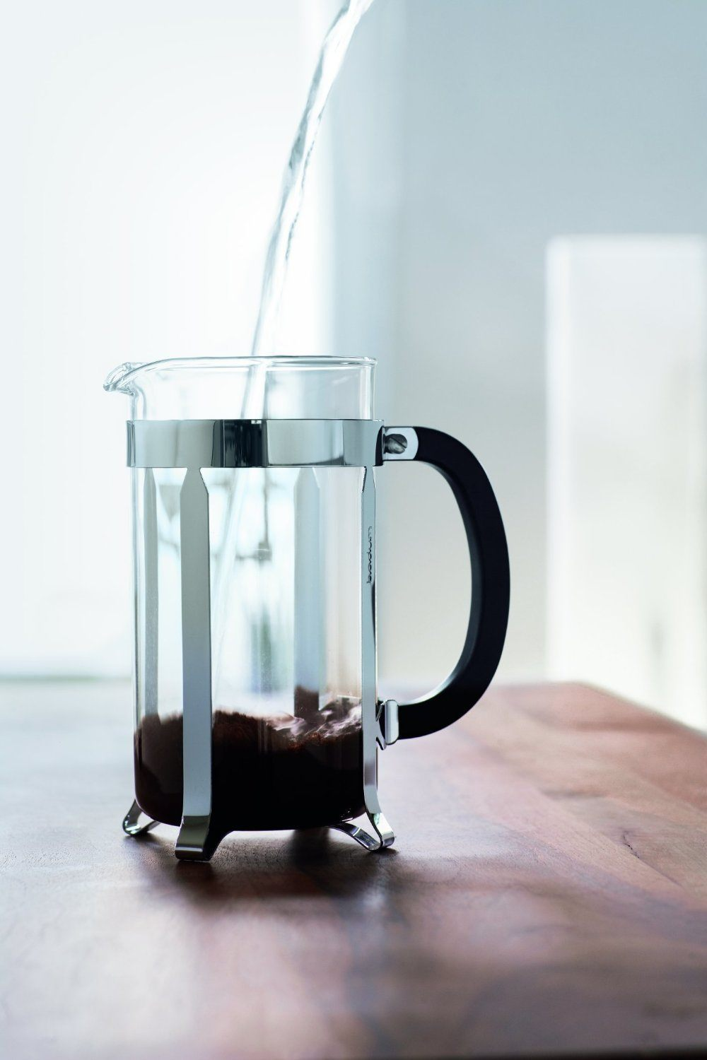 pouring water into a french press